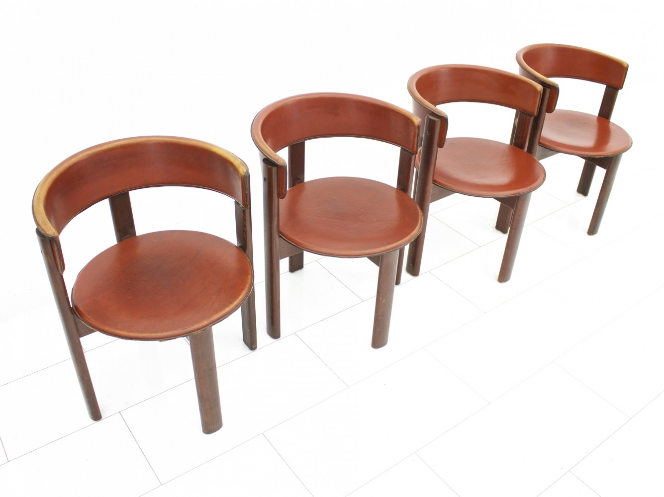 Set of four leather & walnut dining room chairs by Cassina Italy