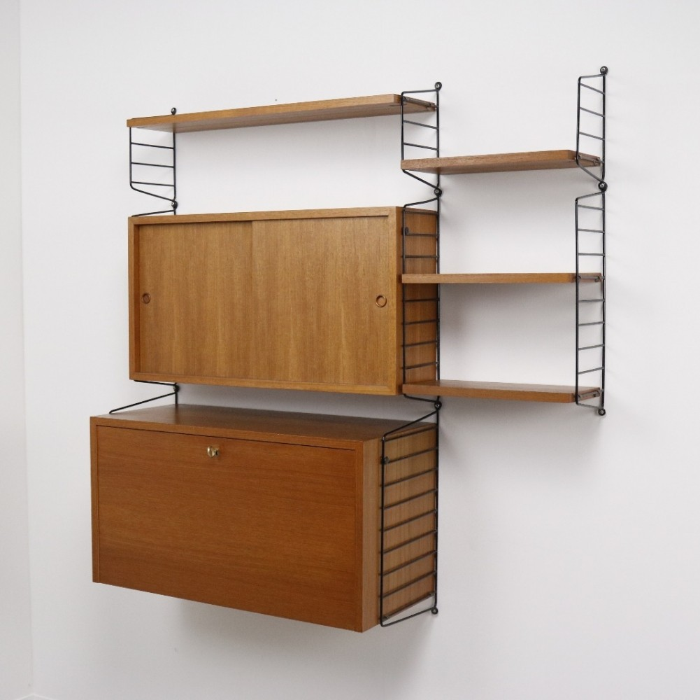 the ladder shelf wall unit from the fifties by nisse strinning for string design ab 64241. Black Bedroom Furniture Sets. Home Design Ideas