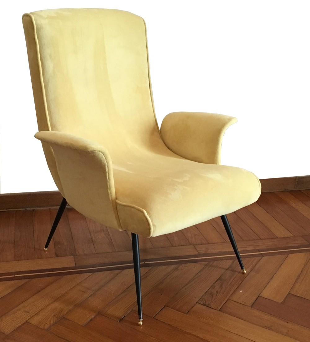 Stylish yellow velvet armchair with brass feet 1950s