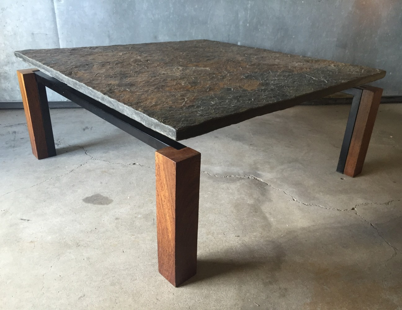 Slate stone  weng  wood   black metal square coffee table  1960s. Slate stone  weng  wood   black metal square coffee table  1960s