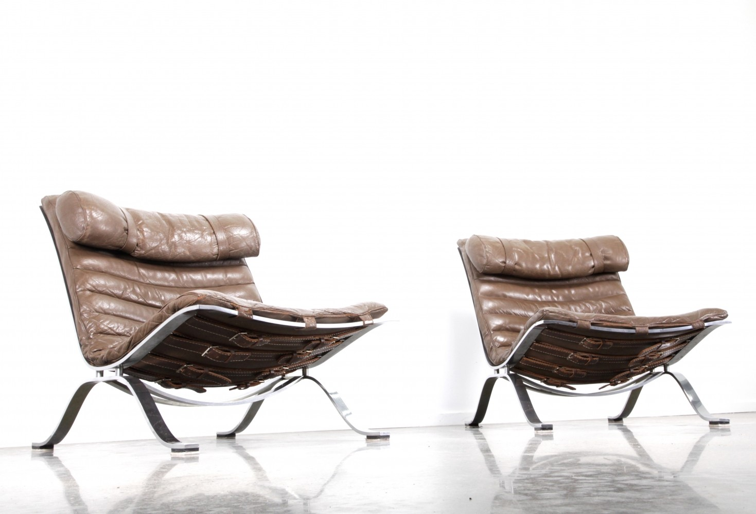 Set of Ari chairs by Arne Norell in brown leather