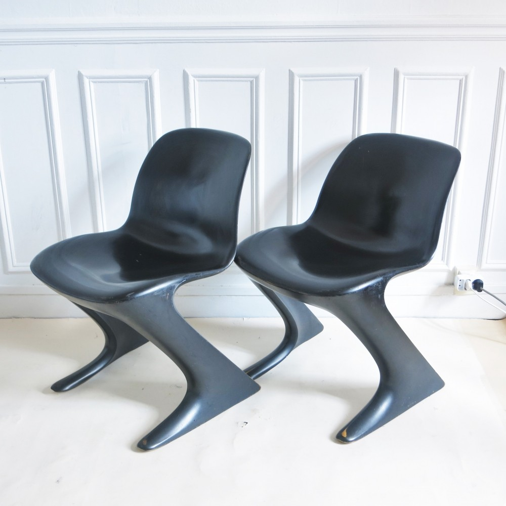 Pair of black Kangaroo Chairs by Ernst Moeckl