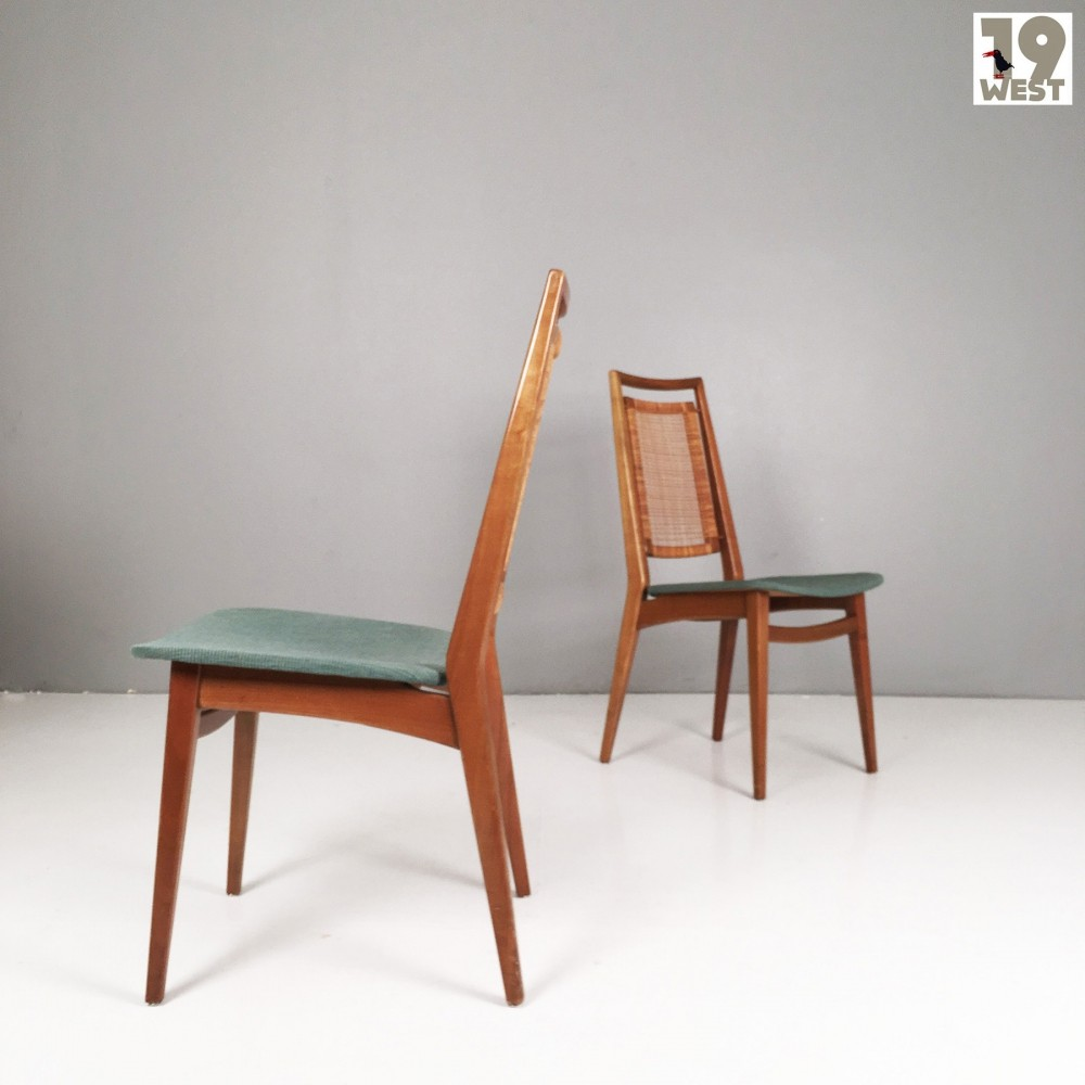 Two modernist walnut dining chairs from the 1950