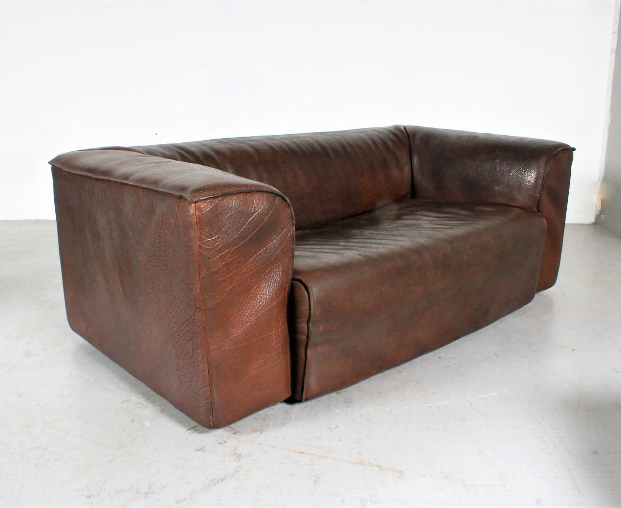 Rare De Sede neckleather sofa by Robert Haussmann in cigarro colour