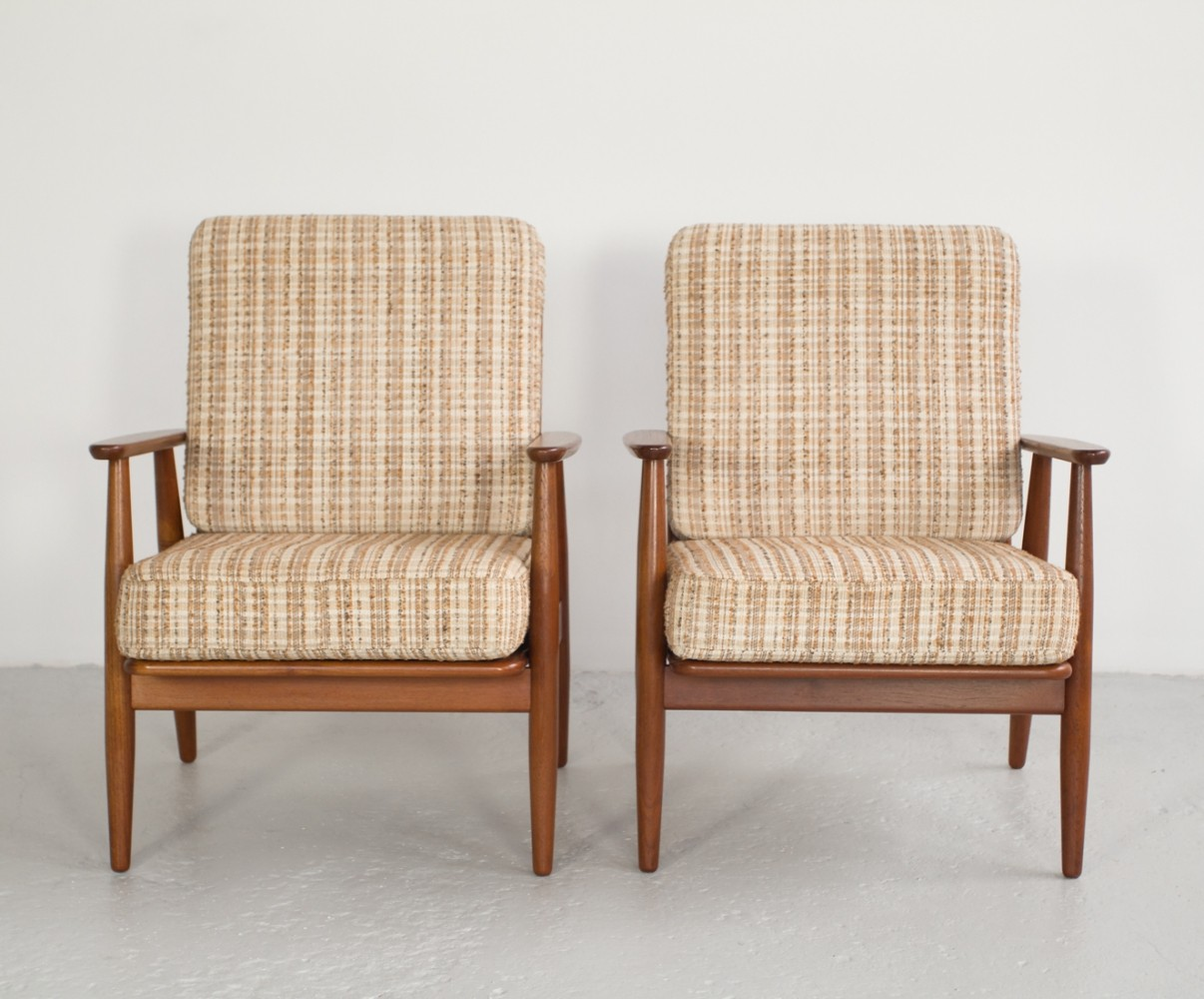 Pair of Danish easy chairs in teak, 1960s