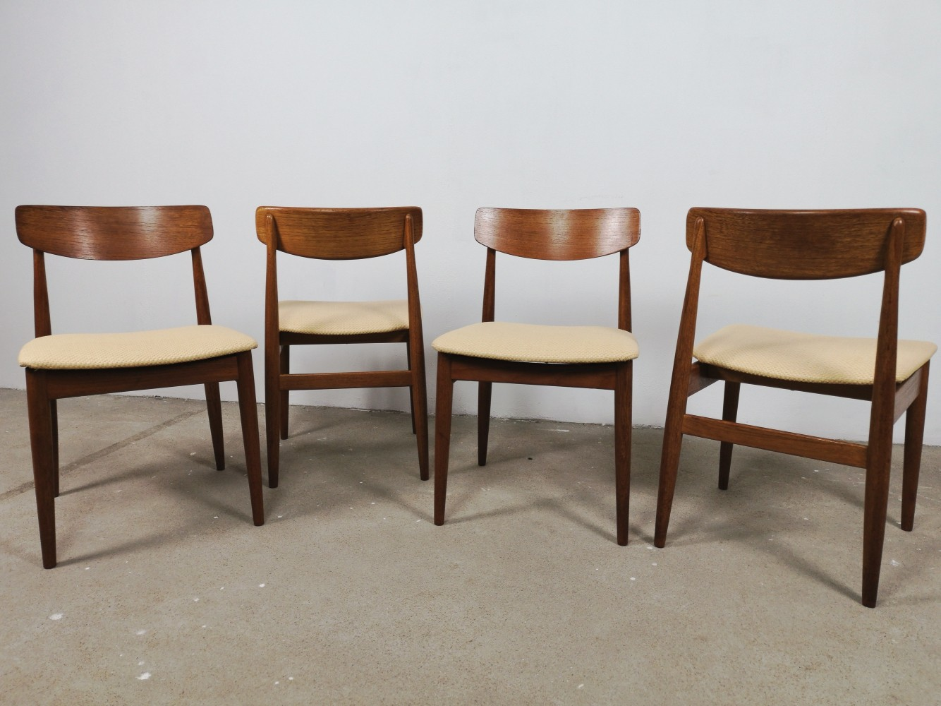 Set of 4 teak dining chairs by Casala