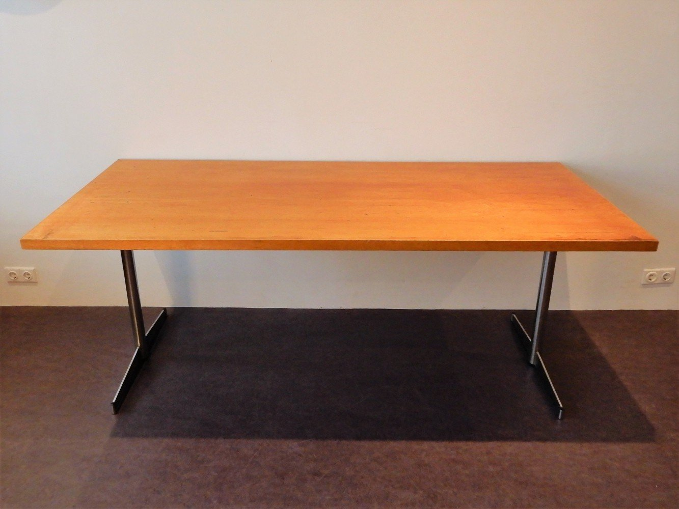 Large industrial dining table from former school building