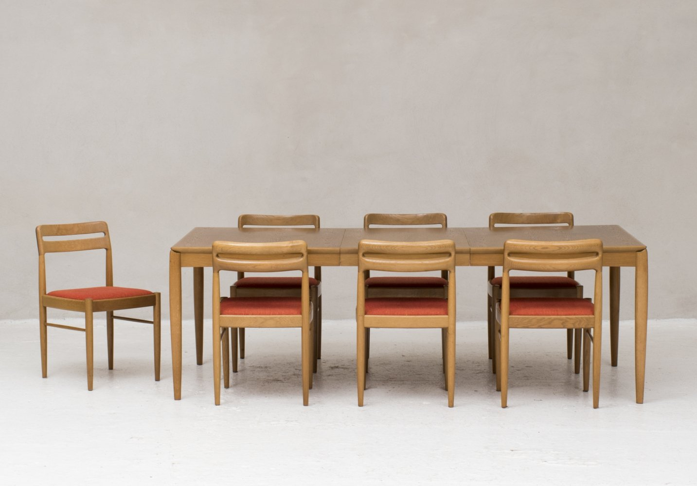 Extendable dining table with 7 matching chairs designed by H.W. Klein for Bramin