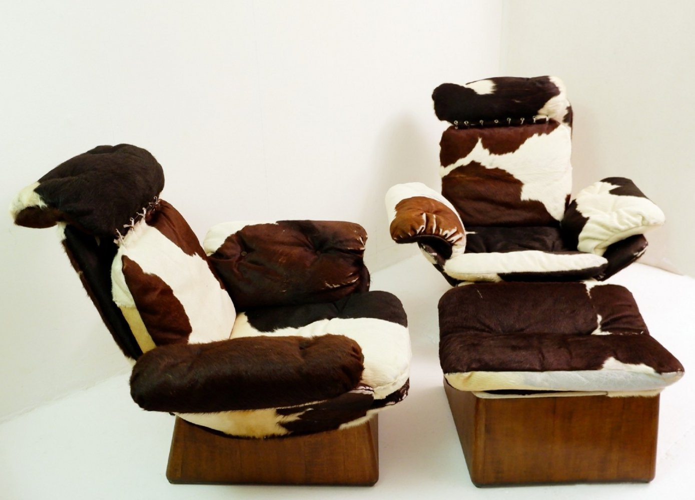 Pair Of Cowhide Armchairs And Ottoman, 1960s
