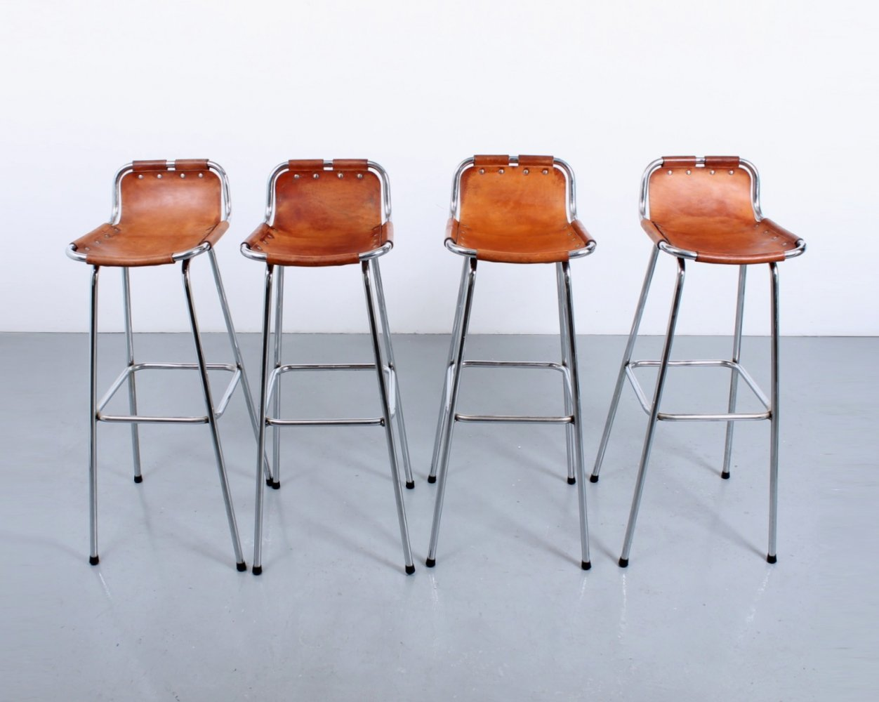 Set of 4 Les arc stools by Charlotte Perriand, 1960s