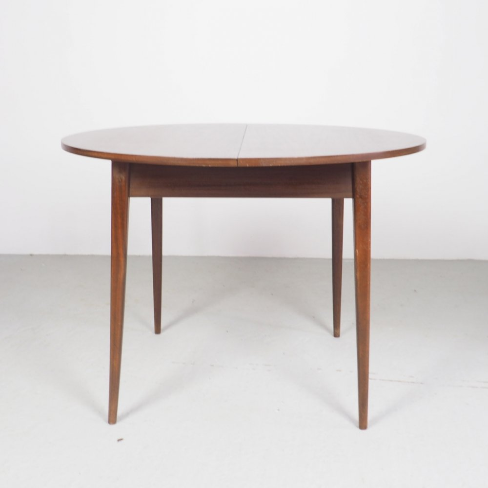 Round teak dining table with extension sheet, 1960