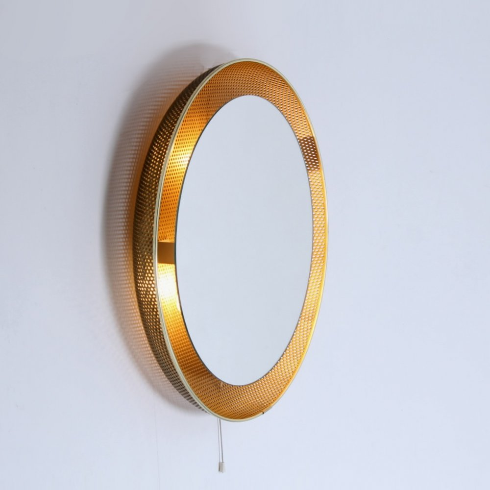 Round brass color back lit illuminated mirror by Floris H. Fiedeldij & Mathieu Matégot for Artimeta