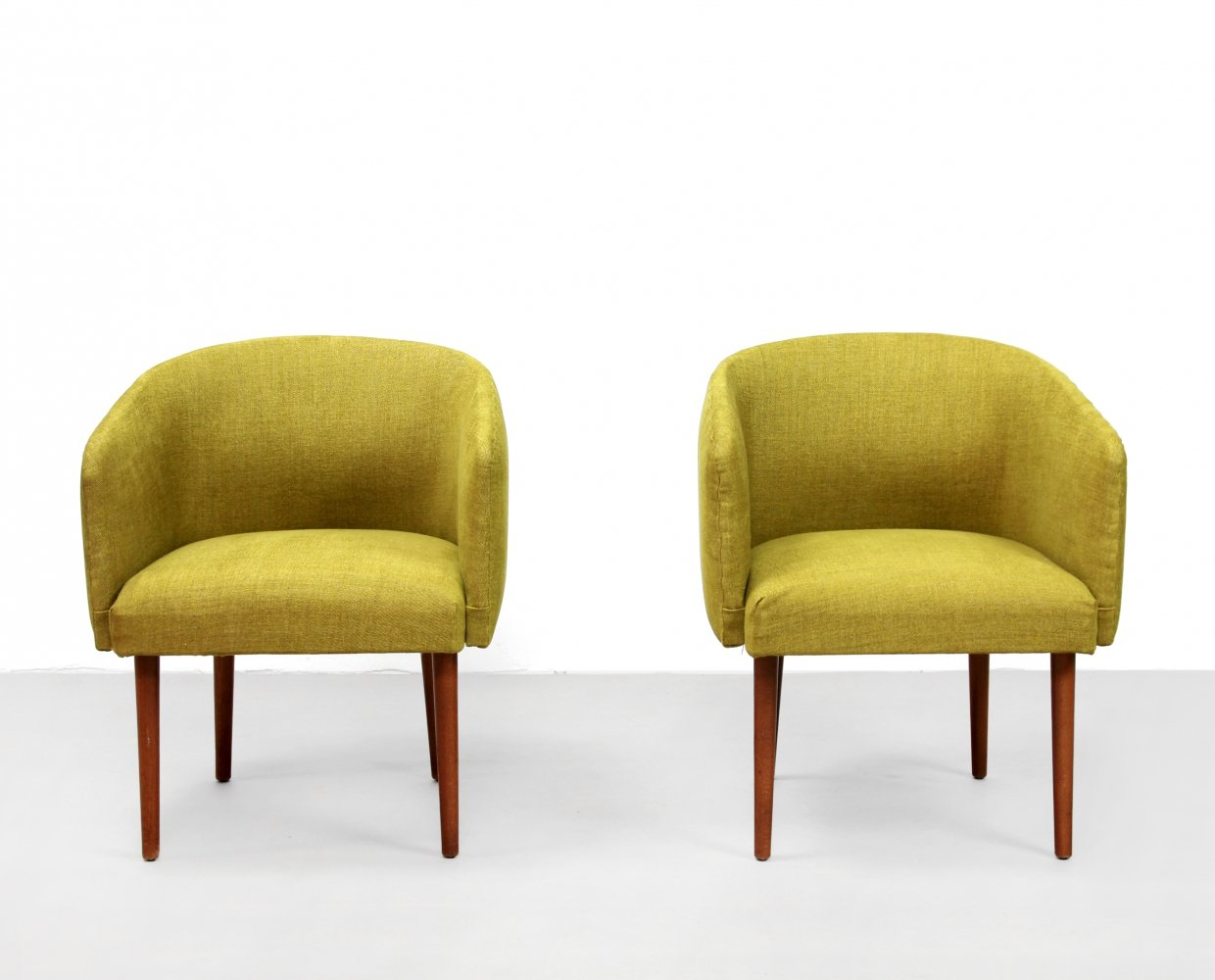 Set of two yellow mid century modern club chairs