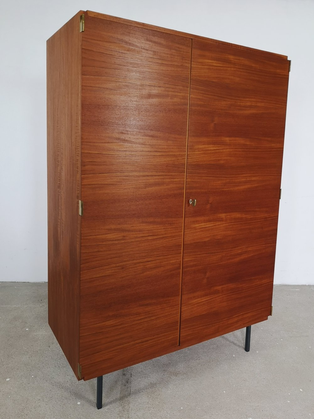 Teak wardrobe with gold colored details