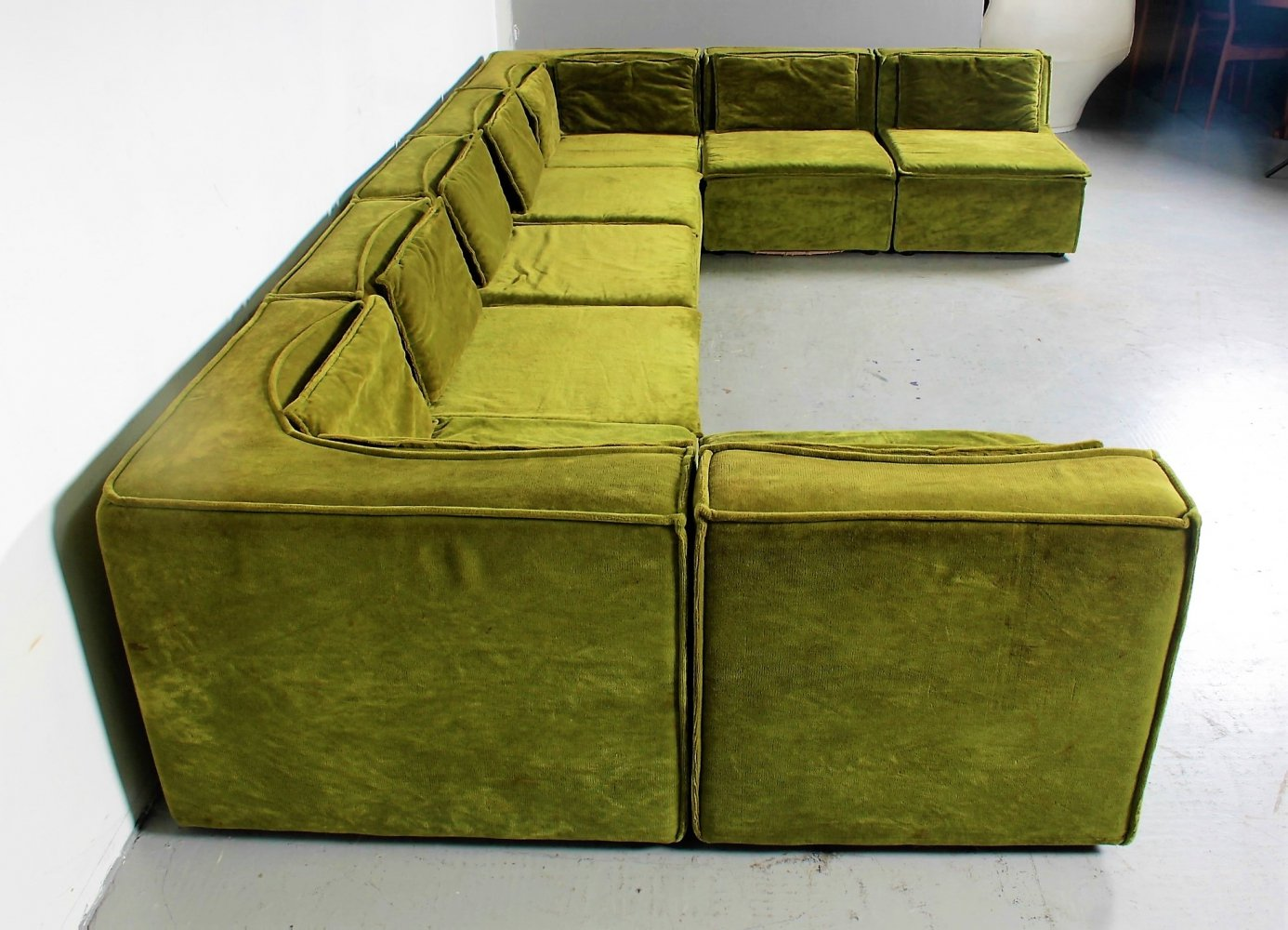 Giant 8 piece sectional sofa in green velvet with additional cushions