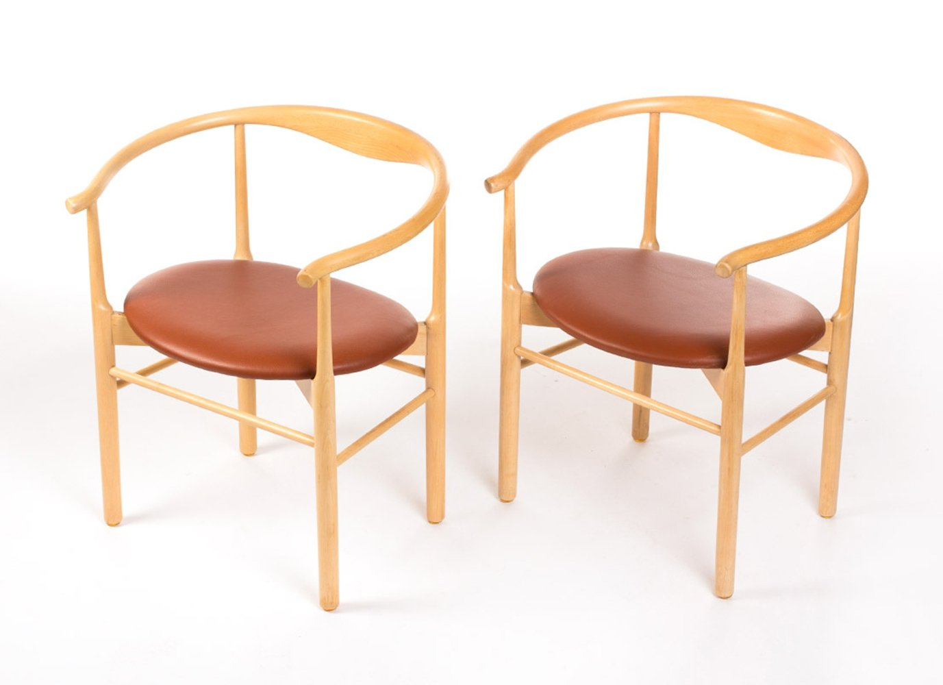 Vintage set of two Danish design chairs in beech wood
