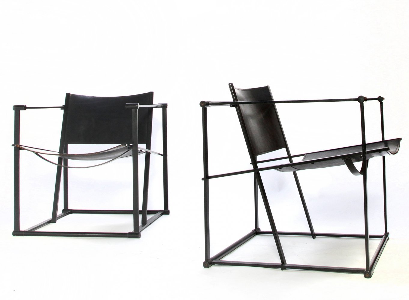 Pair of thick leather arm chairs by Radboud van Beekum for Pastoe, 1980s