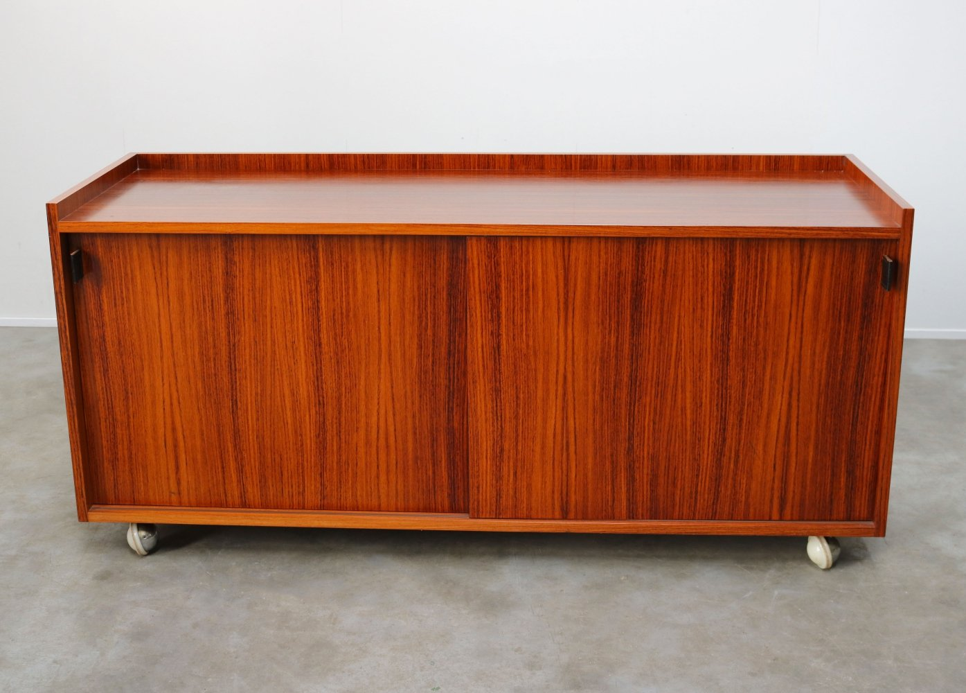 Minimalist sideboard in rosewood by Florence Knoll for De Coene / Knoll, 1960