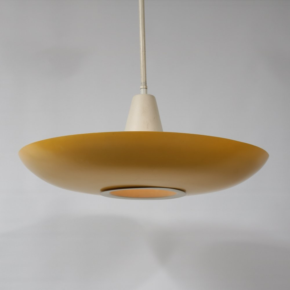 Yellow metal hanging lamp by Louis Kalff for Philips, the Netherlands 1950s