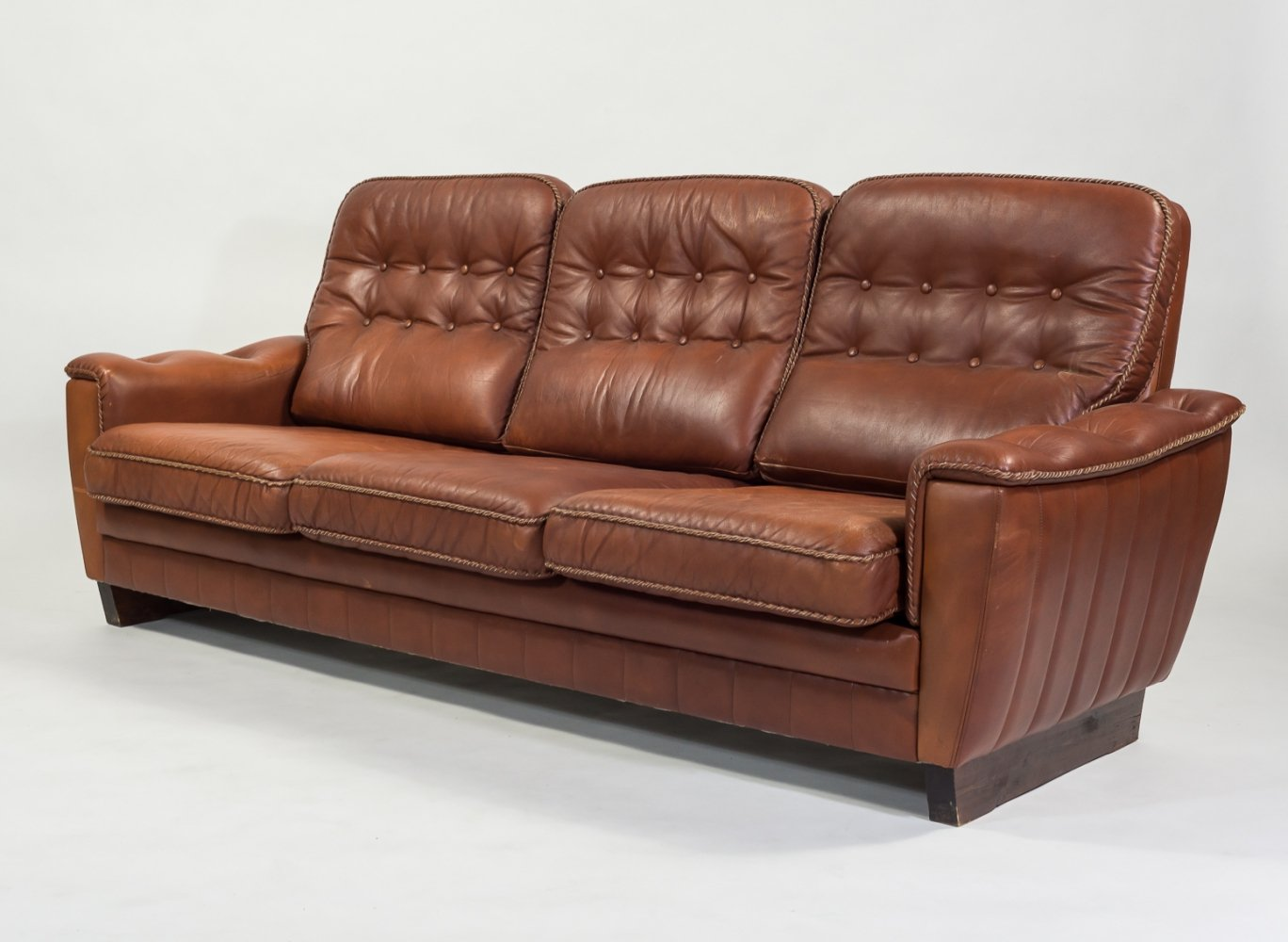 Danish three seats vintage sofa in dark cognac leather