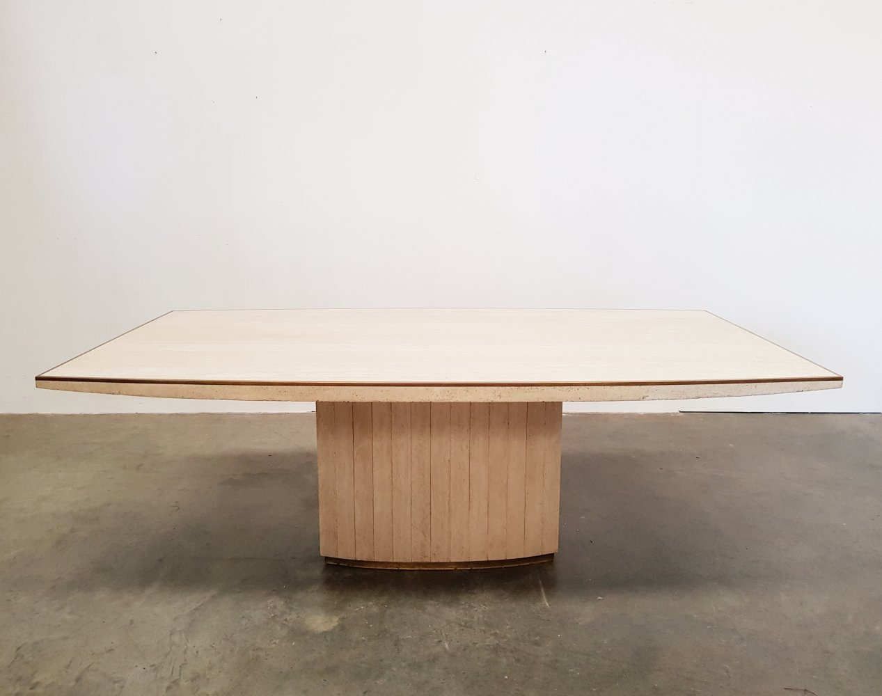 Travertine dining table from Willy Rizzo with brass details, 1970s