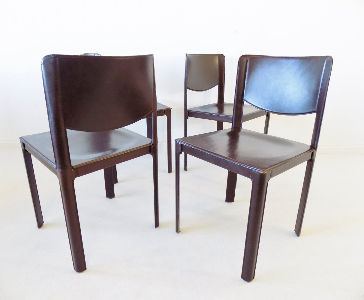 Set of 4 leather dining chairs by Tito Agnoli for Matteo Grassi, 1980s