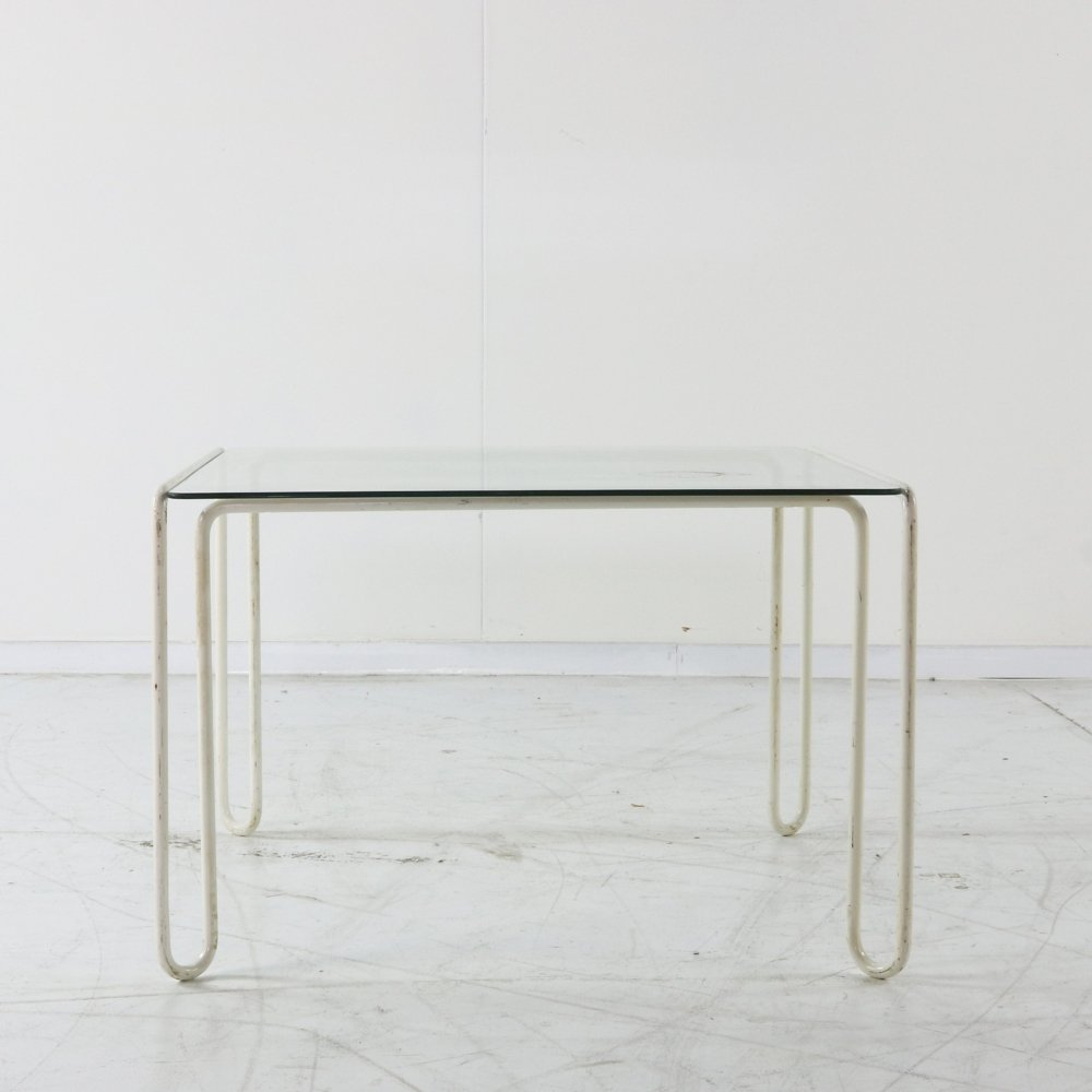 Glass table with tubular wire frame