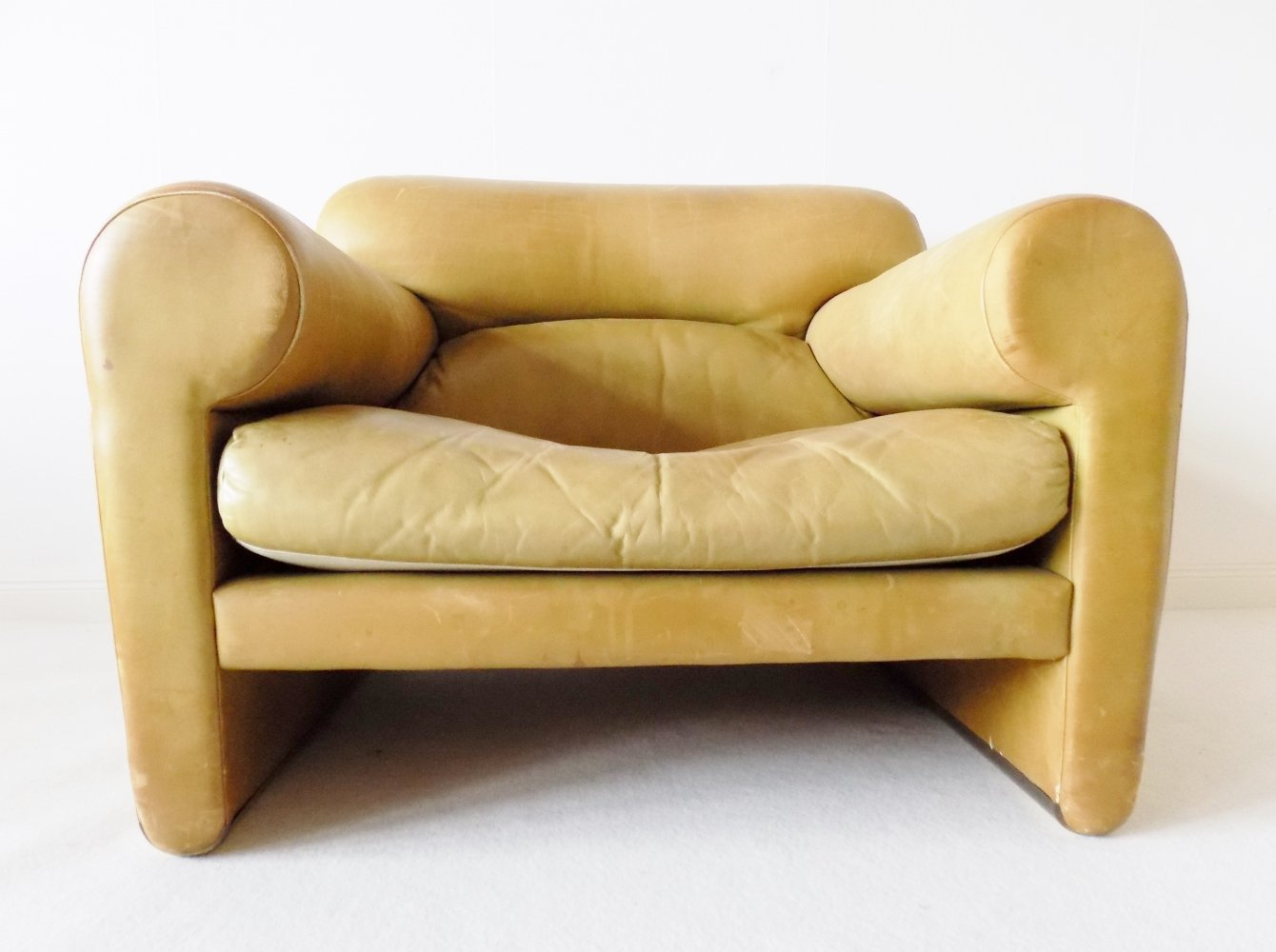 Mustard colored leather arm chair by Poltrona Frau, 1970s