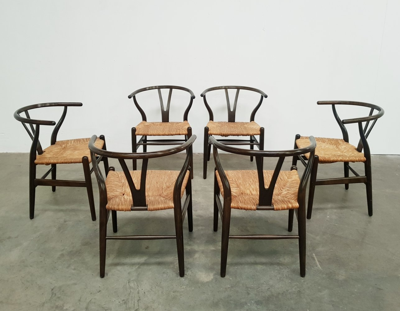 Set of 6 signed brown Wishbone chairs by Hans Wegner, 1980s