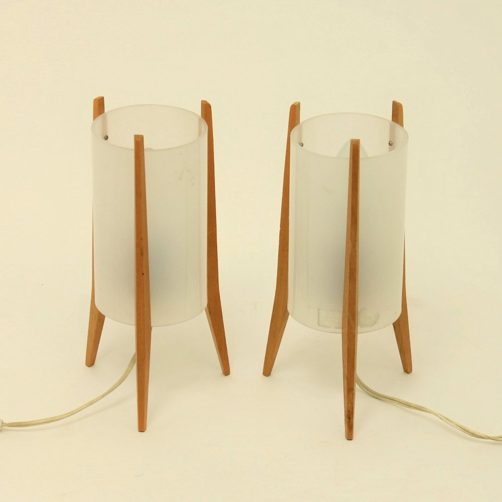 Pair of plexiglass rocket lamps on wooden base