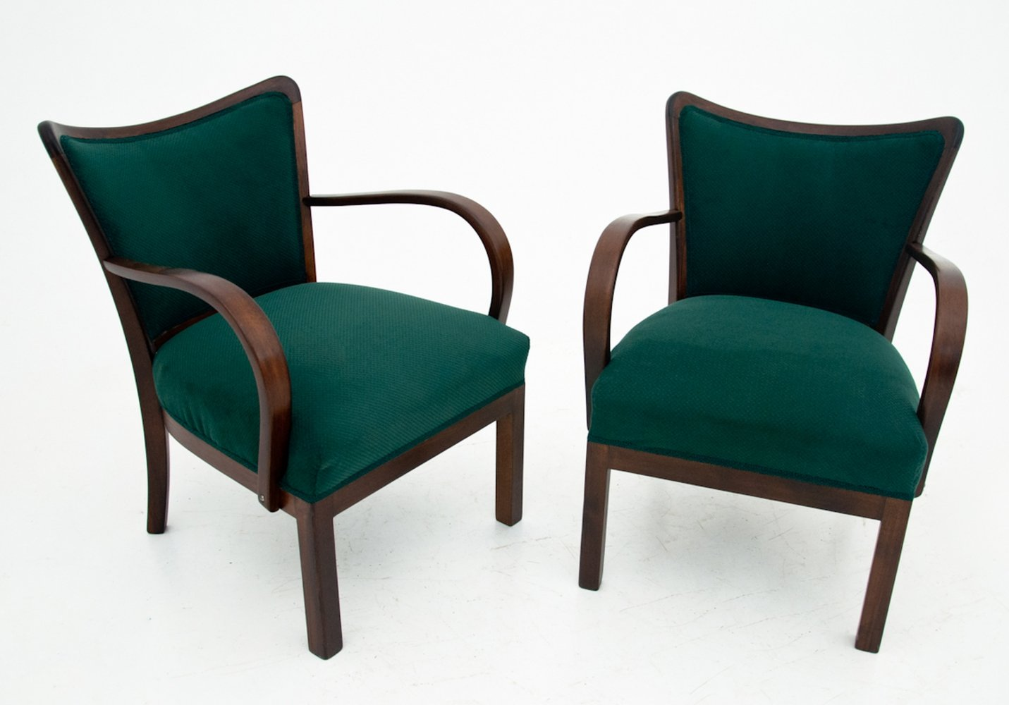 Two green art deco armchairs, 1950s