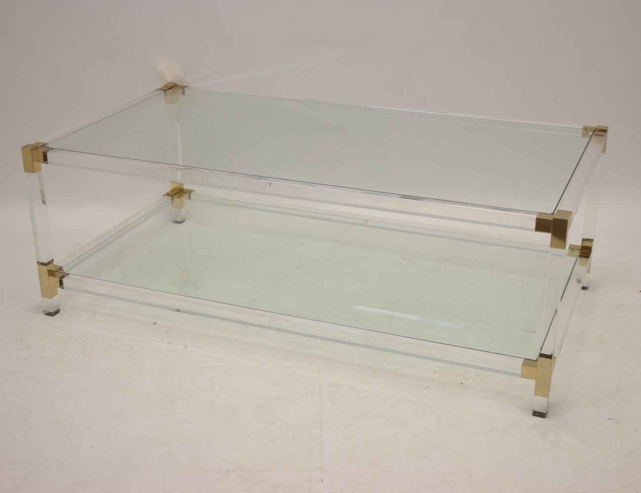 Charles Hollis Jones Plexiglass Coffee table with golden corners, 1970s