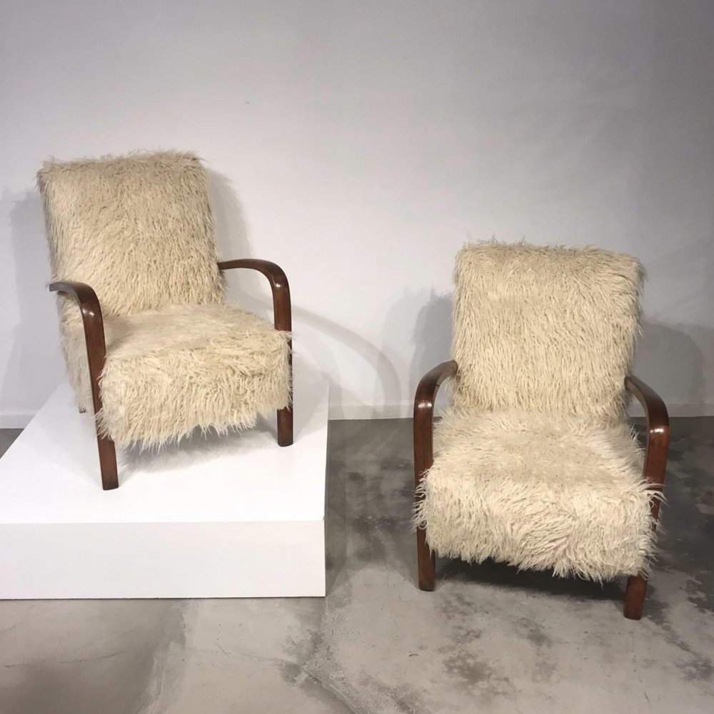 Pair of faux fur easy chairs, 1970s