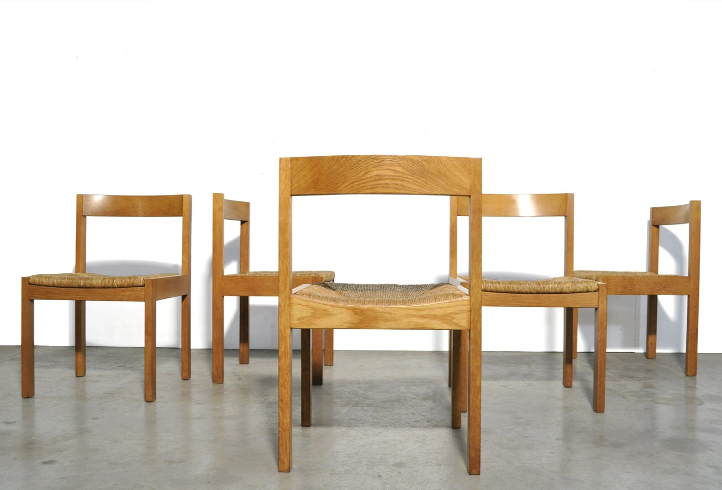 Set of 5 solid oak dining chairs with reed seat & wooden back, 1970s