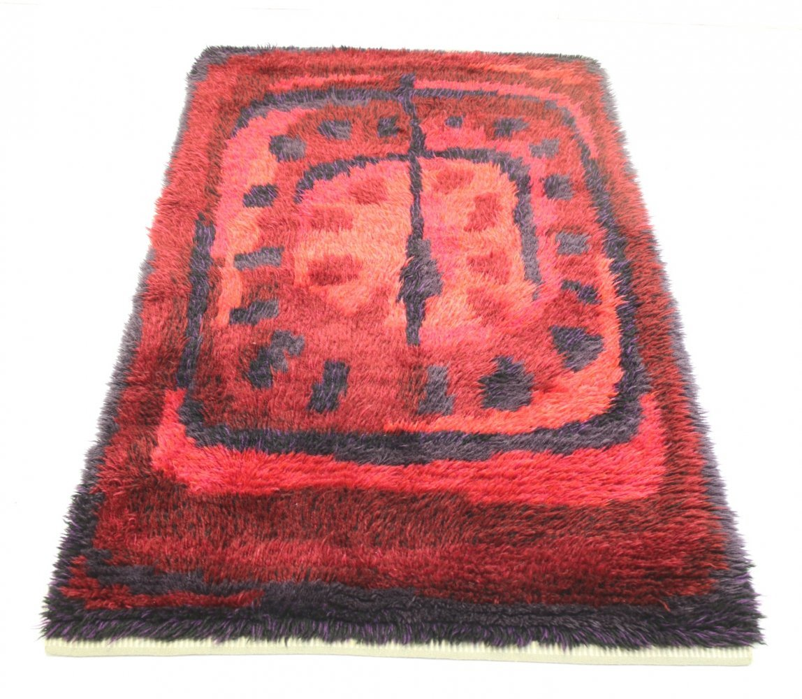 Hand-knotted wool rug in red, 1960s