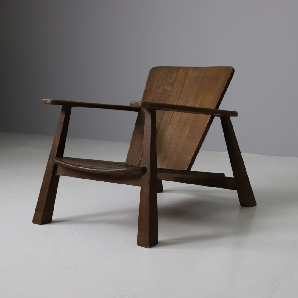 Early modernist lounge chair in patinated oak, 1940s