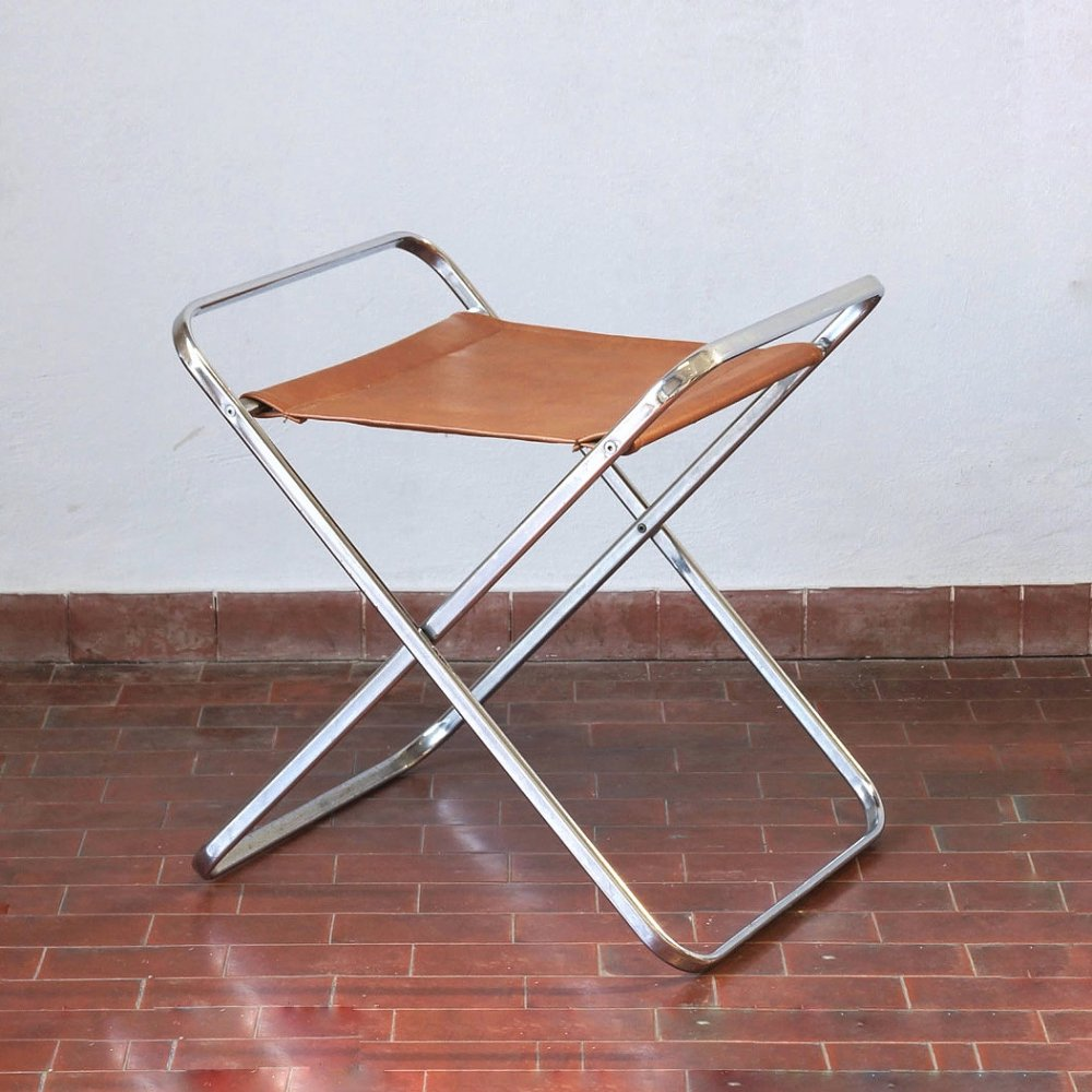 Low magazine rack / stool in leather & steel