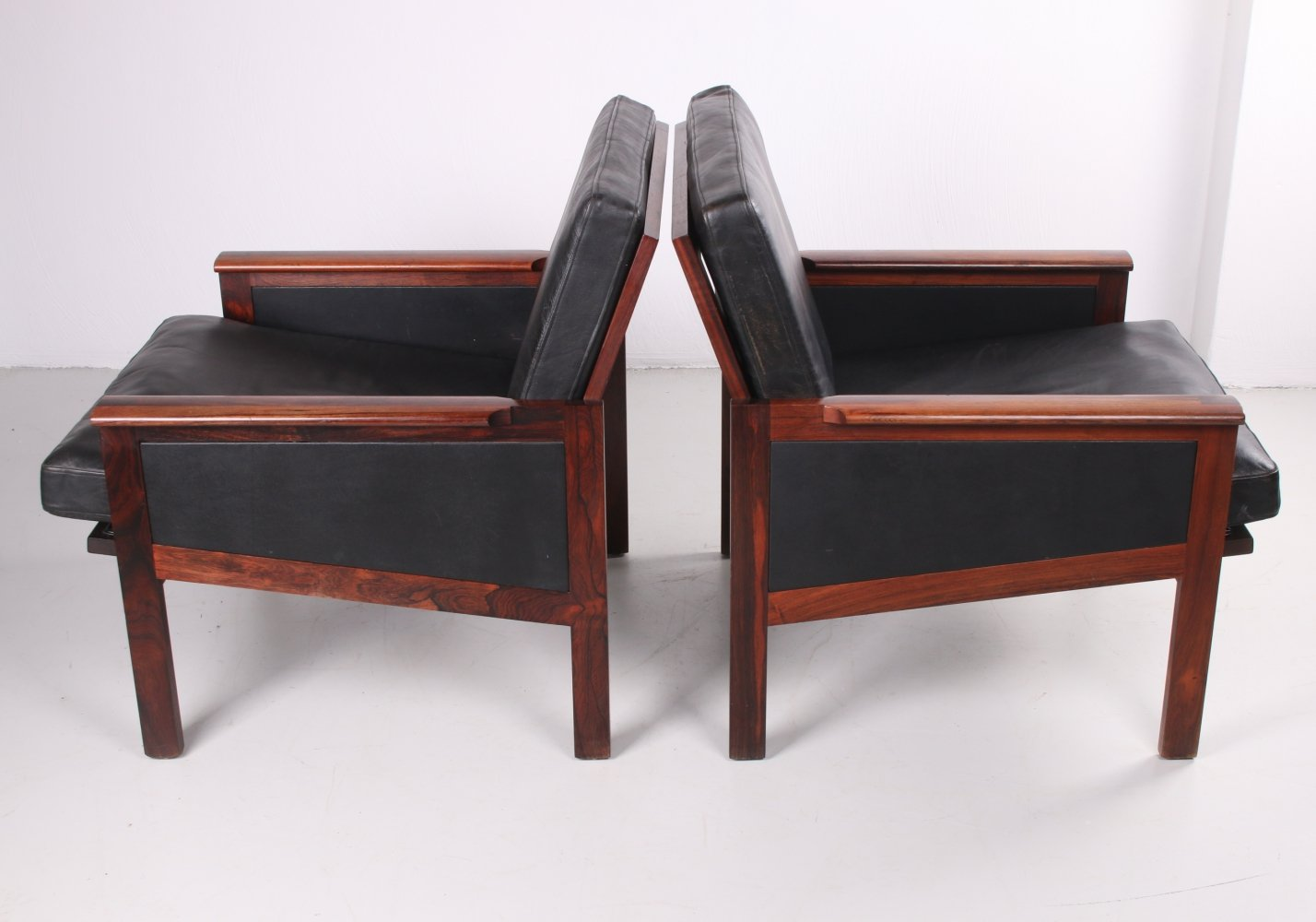 Pair of black leather Capella arm chairs by Illum Wikkelsø, 1958