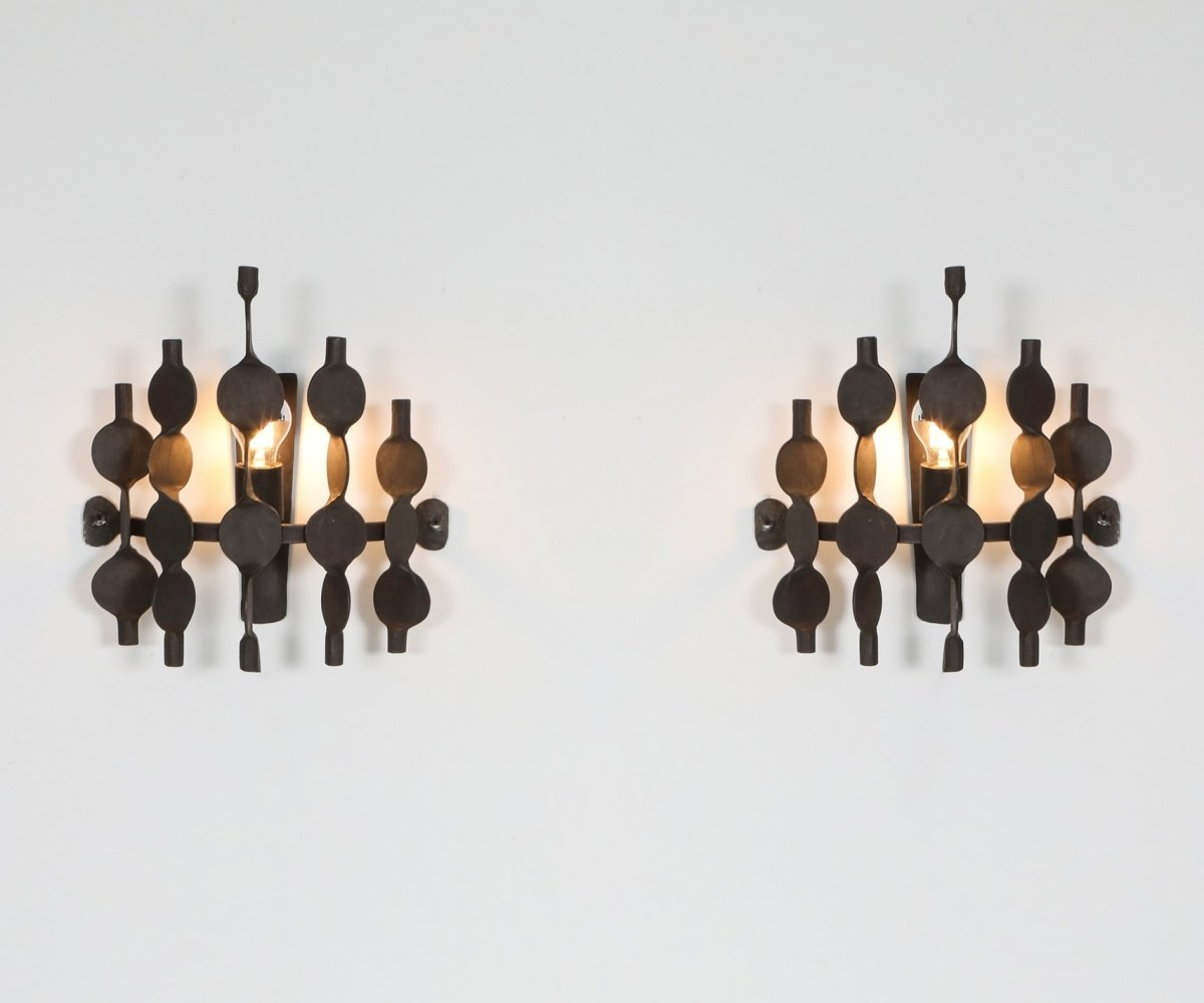 Pair of Brutalist forged iron wall sconces by Atelier Français, 1970