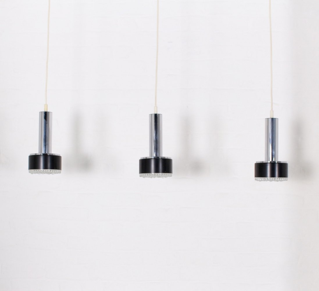 Set of 3 chromed steel & pressed glass suspensions, 1970