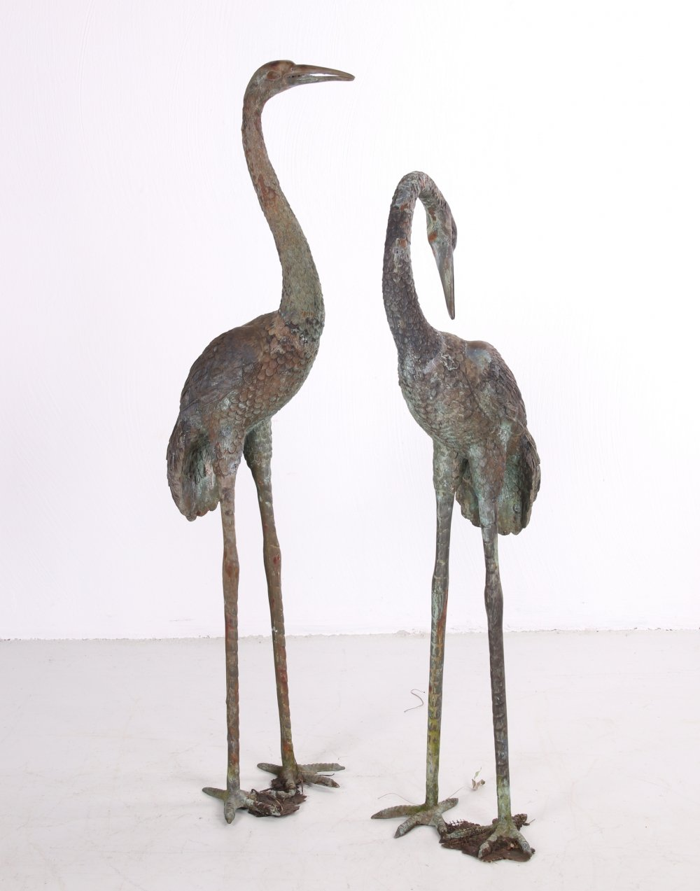 Two large bronze cranes in Hollywood Regency style, 1970s