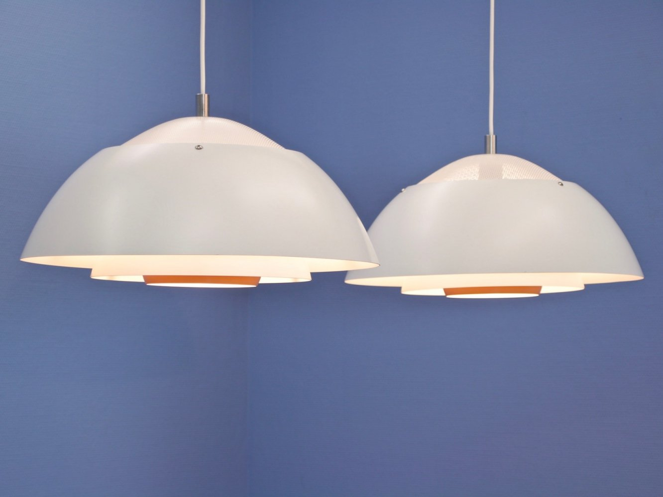 Set of 2 Danish hanging lamps in white with orange accent, 1970s