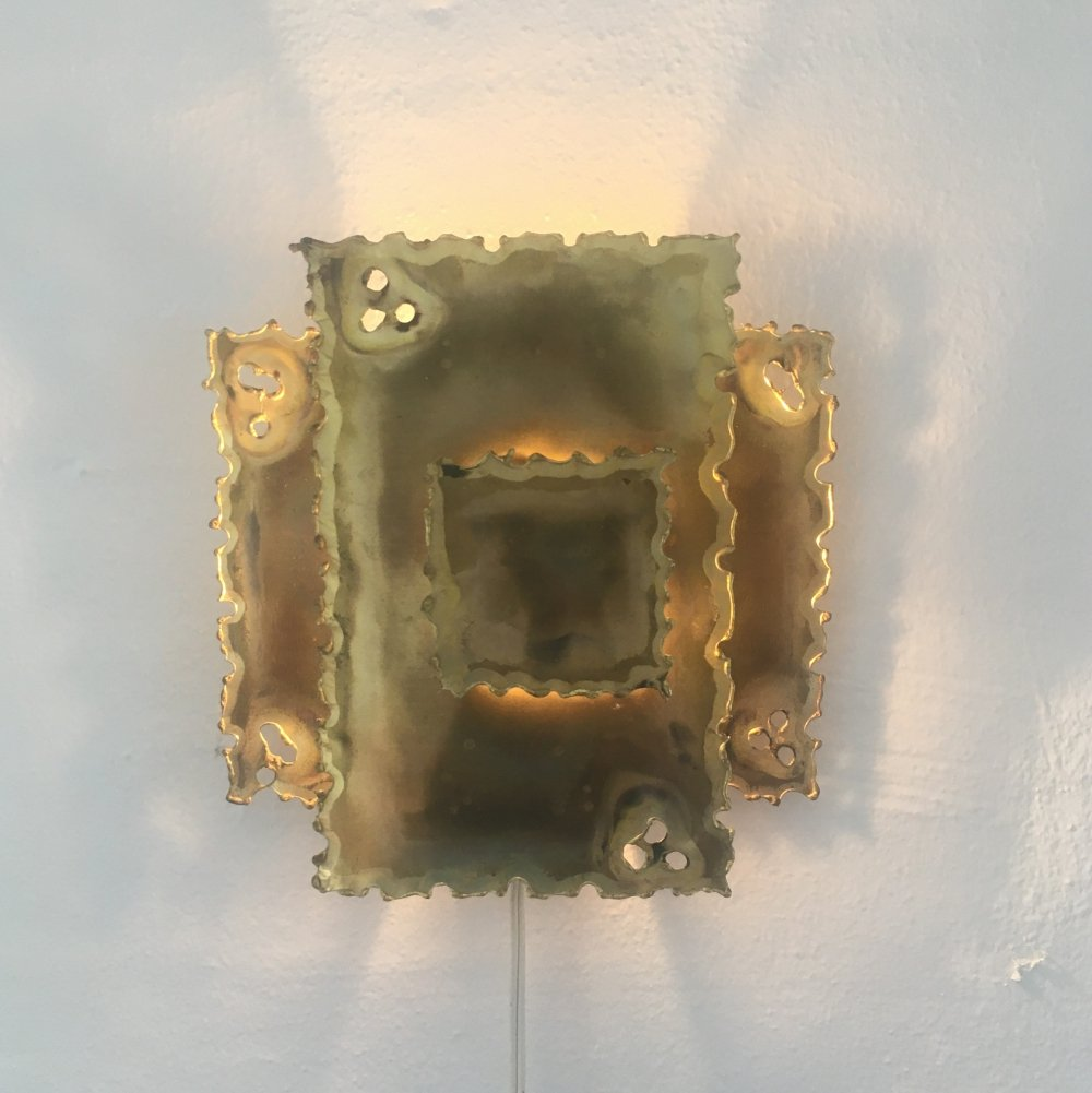 Flame cut brass wall sconce by Svend Aage Holm Sørensen, 1970s