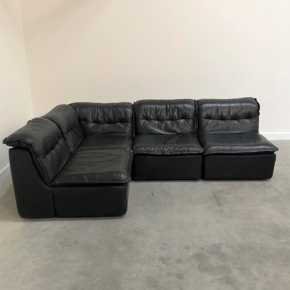 Vintage black leather sofa by Laauser, 1970s