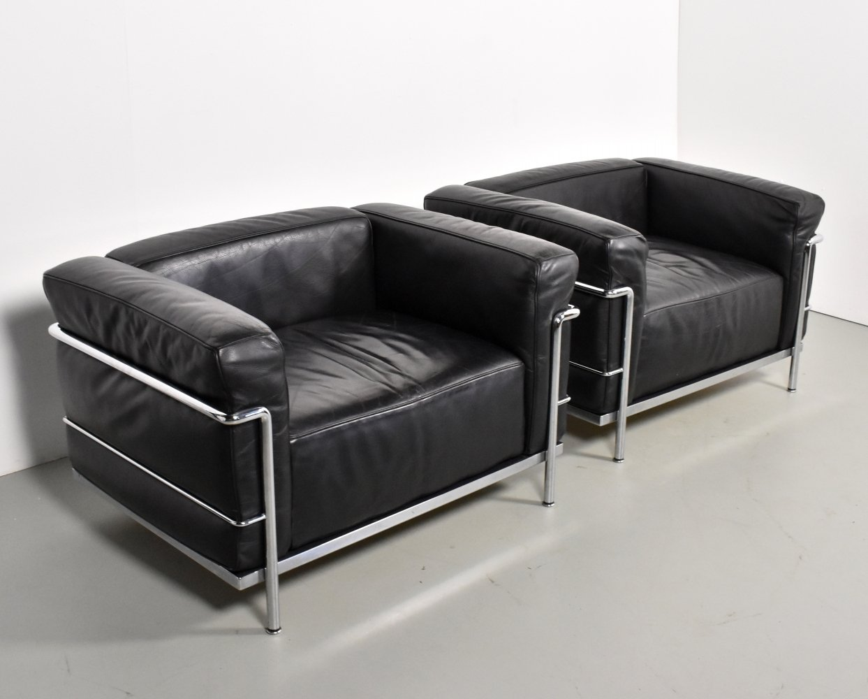 2 x LC3 lounge chair by Charlotte Perriand & Le Corbusier for Cassina, 1990s