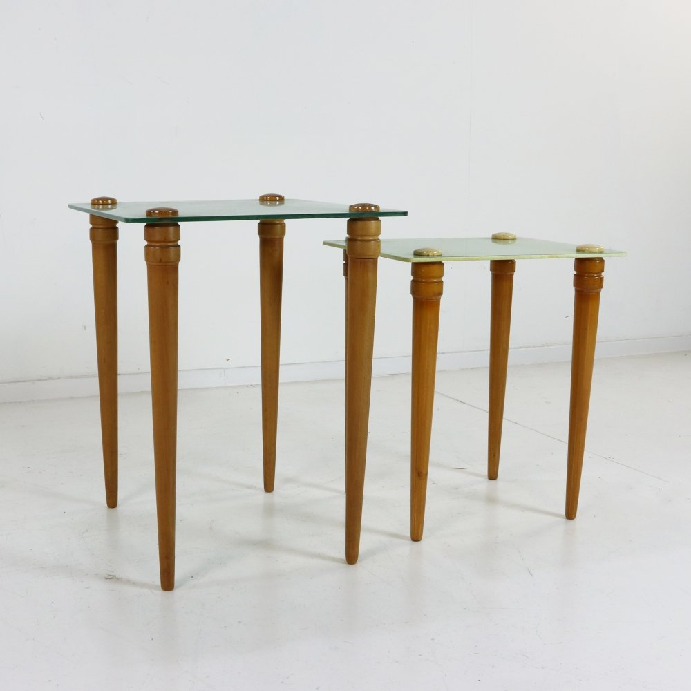 Set of two wooden side tables with glass top
