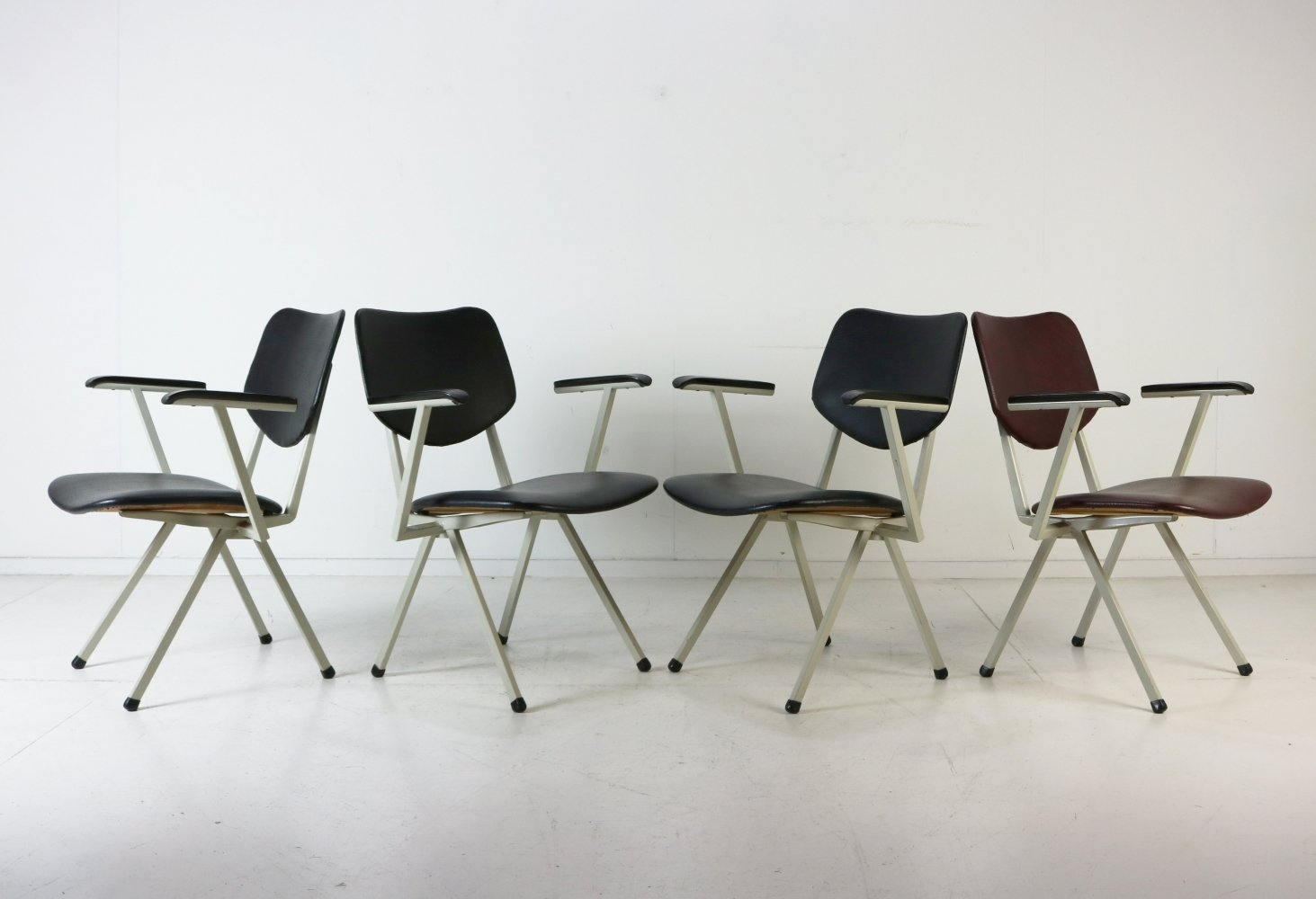 Dutch industrial design low seat arm chairs, 1960s