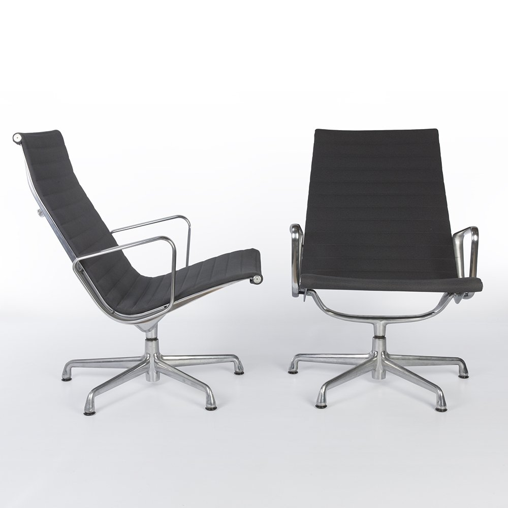 pair of alu group office chairs by charles ray eames for