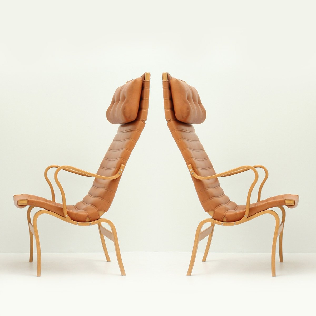 Pair Of Eva High Back Chairs By Bruno Mathsson