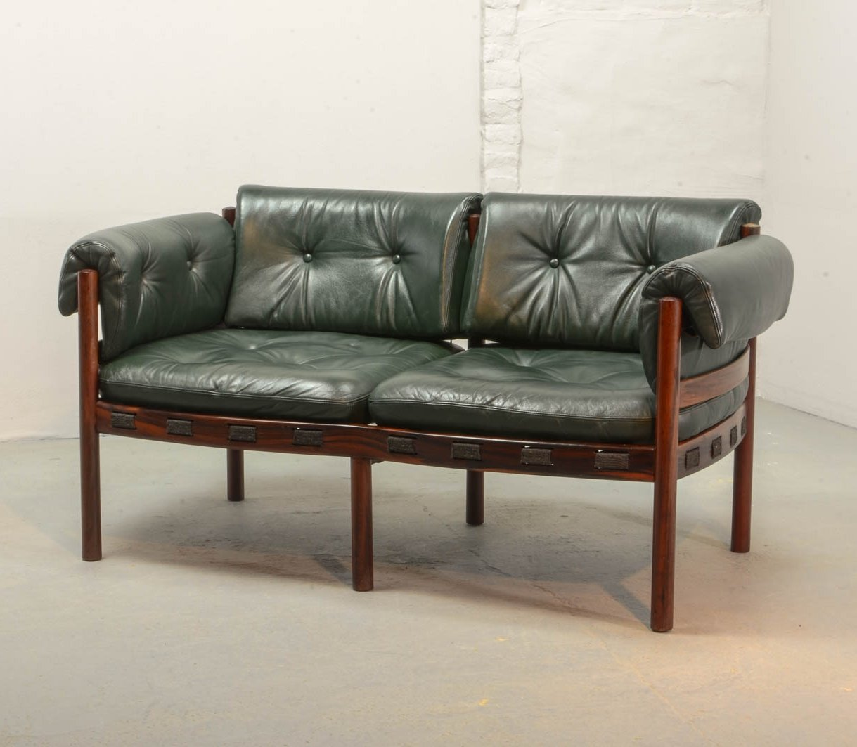 Two seat rosewood green leather sofa by arne norell for coja 1960s